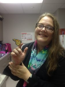 Cindy Leonard with a live butterfly perched on her hand